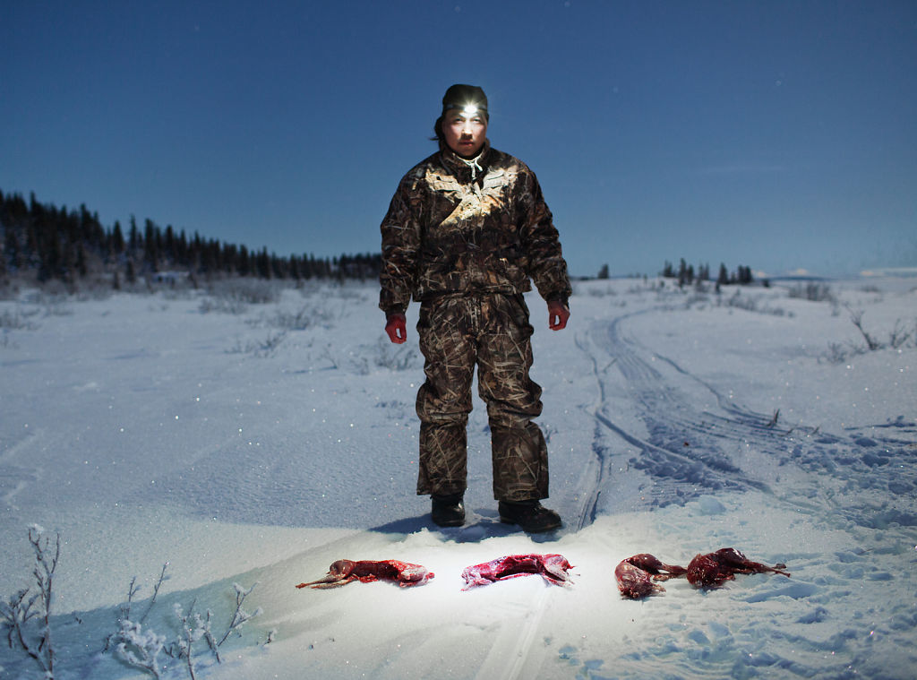 Hunter with Arctic Hare